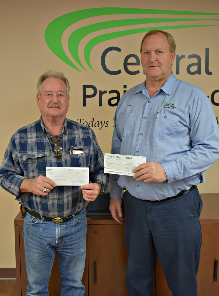 L to R: Northern Rice Country Food Bank Director Robert Johnson and CPC General Manager Joe Schauf