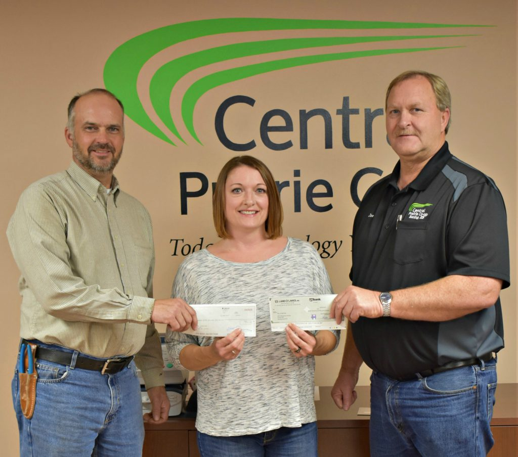 L to R: CPC Chairman of the Boad of Directors Mark Engelland, Sterling Food Bank Director Bridget Bennett, and CPC General Manager Joe Schauf