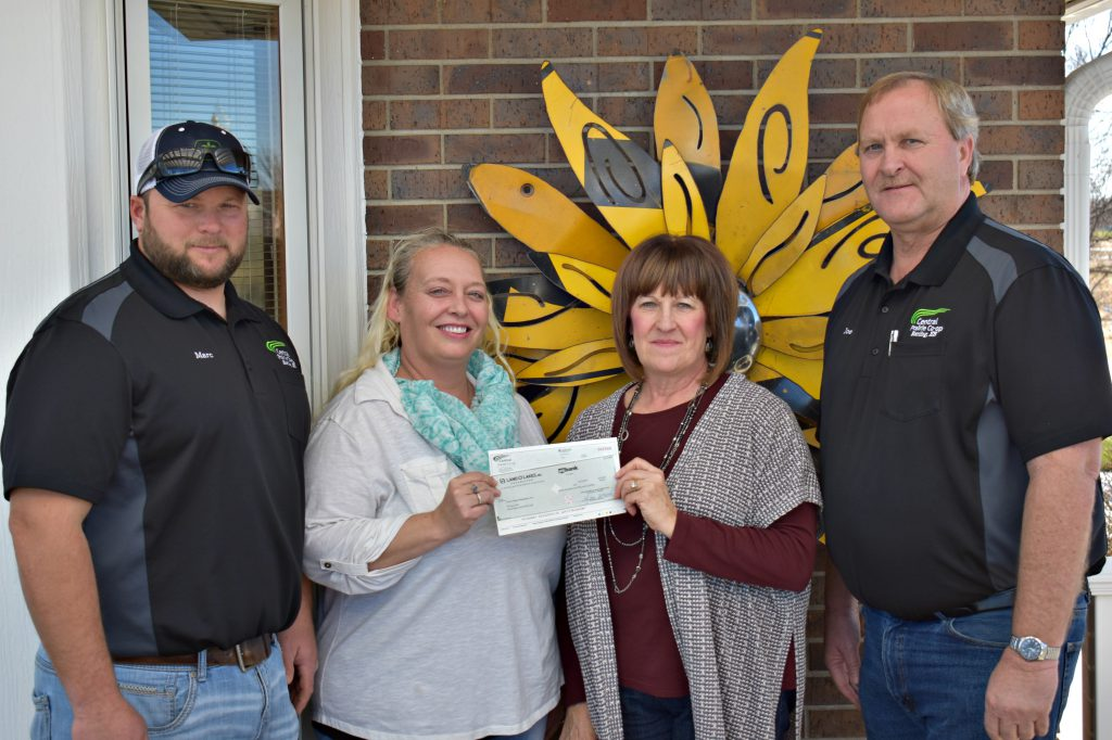 L to R: CPC Board Member Marc Stickney, CPC Agronomy Administrative Assistant Heather Story, Camp Hope Board Member Gail Moeder and CPC General Manager Joe Schauf